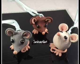 Super cute little mice, hanging models, hand sculpted from polymer clay, ribbon attached to hang the. Anywhere.
