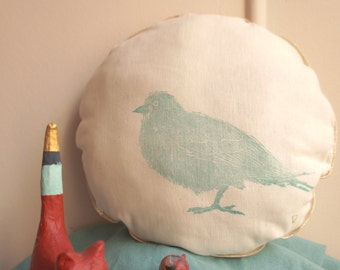 Cushion round linocut bird motif