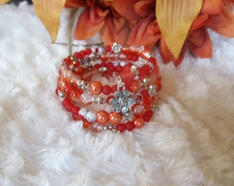 Statement spiral bracelet with orange Crackle glass beads