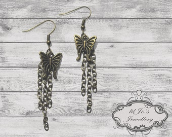 Butterflies with chain dangles.