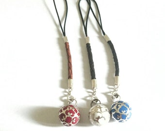 Mobile phone strap with silver harmony ball