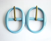 Baby blue plastic buckles, oval belt buckles in 2 sizes to choose from, unused sewing supplies!!