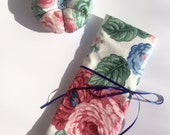 Small organizing roll for crochet hooks, knitting needles, paintbrushes or artists tools with matching pincushion