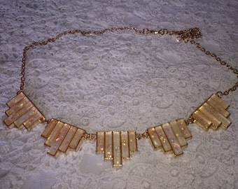 Art Deco style goldtone and soft pink necklace.