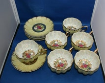 NASCO Del Coronado Hand Painted Courting Scene Tri-Footed Lusterware Teacup and Saucer set of six circa 1950 Made in Japan