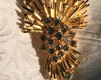 M.Jent Gold Tone burst brooch with clear rhinestones