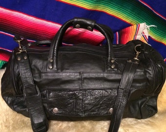 Small black vintage leather duffel bag