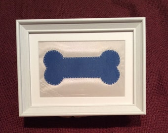 Framed Sailcloth Dog Bone Picture