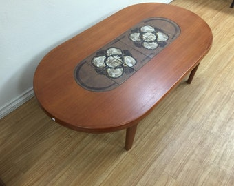 Ceramic and teak danish modern coffee table .