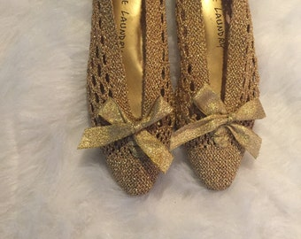 Gold pointy bow flats size 7
