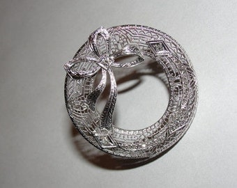 Art Deco 14 kt White Gold Filigree Circular Pin with Ribbon Mine Cut Diamonds