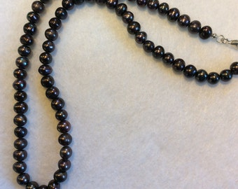 "18"" Strand of Black Freshwater Water Pearls with Sterling Silver Clasp"