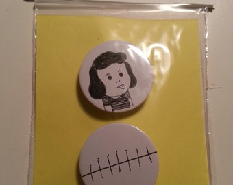 pair of original drawings on pin buttons or badges