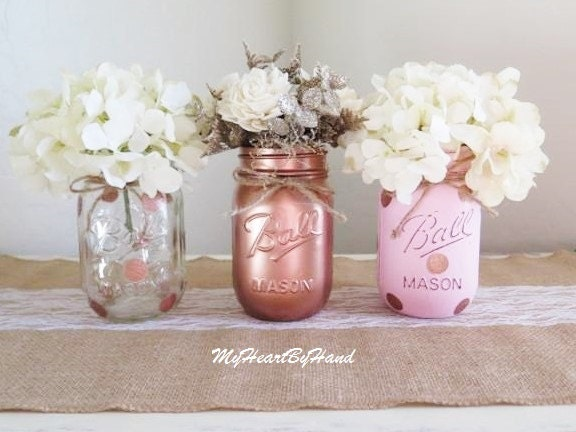 Pink and rose gold mason jar centerpieces baby shower