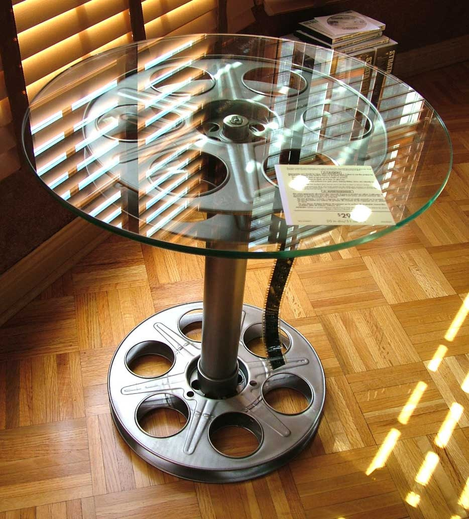 5 Must Haves For Creating The Ultimate Basement Home Theater: 35mm Movie Reel Tables