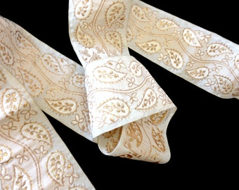 """Off-White and Coppery Gold, lurex and polyester ribbon, 2.25"""" wide, from the 2000's, offering it in 3 yd. increments, 6 lots available."""
