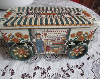 Treasure tin with tin riveted wheels that work and lid KELLER-CHARLES PENSYLVANIA