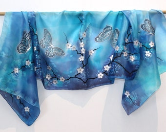 "Hand Painted Silk Scarf, blue scarf with flowers, cherry blossom and butterflies. Approx 18"" x 71"" (45 x 180 cm)."