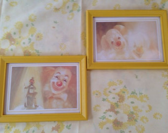 Vintage small yellow framed clown prints
