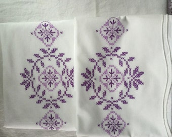 Vintage pillowcases pair with purple crosstitch