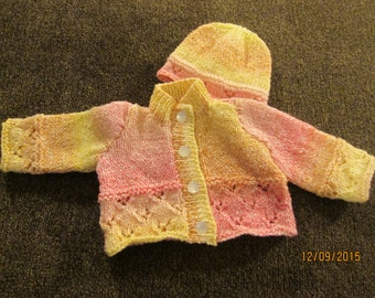 newborn handknit cardigan in pinks and yellows