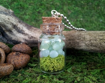 Celadon: Faerie Flask miniature glass bottle necklace vial pendant with pale green glass pebbles and moss, on bead ball chain