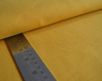 Organic cotton jersey knit ribbed fabric for cuffs. Gold. By Shalmiak, Sari Ahokainen. Per 1/2 metre.