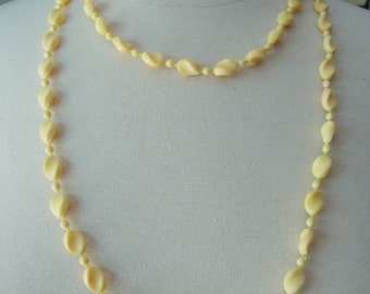 Vintage Old Plastic Cream and Light Orange Tones Long Beaded Necklace.
