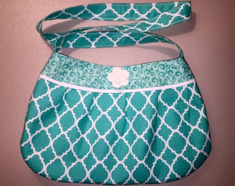 Teal and white pleated purse