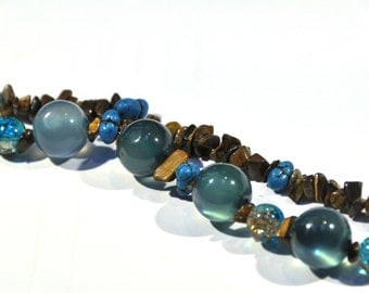 Bracelet consisting of 2 strands with assorted beads in shades of Brown and aqua