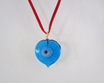 Blue Moon glass heart shaped pendant on 'faux' leather.