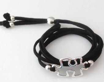 Black Leather Bracelet with Silver Puzzle Piece Charm Cutout