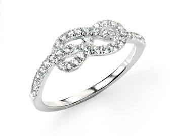 Silver infinity ring with clear cubic zirconia