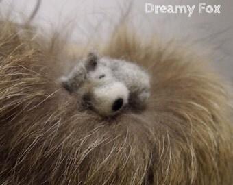 Needle felted dog.