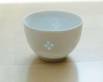 Japanese fine tea cup with glowing flower motif, bone china, ochono, sake cup