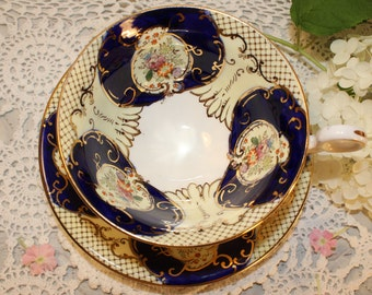 Fenton: gorgeous tea cup and saucer, white and blue