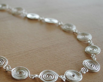 Silver Spiral Necklace (open and closed) jewellery