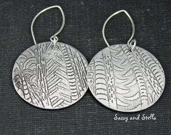 Rustic, lightweight, aluminum dangle earrings.