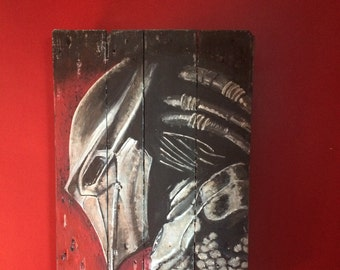 Painting Predator on recycled pallet wood