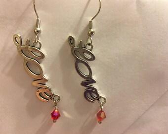 """Silvertone """"love"""" word earrings  F21"""