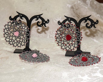 Earrings made in grey with pink resin beads and tatting