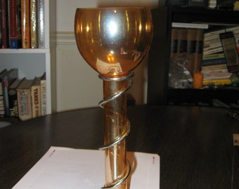 Beuutiful Golden Glass Floating Candle Holder (see second picture to get a better idea of its sheen).
