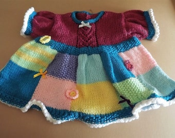Patchwork hand knitted Dress in a rainbow of colours. 6-12 months.