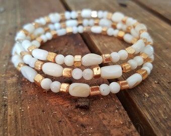 Shell beads, memory wire bracelet. Gold and cream.