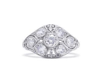 Edwardian 7 Stone Diamond Ring In Platinum, c.1910, Old Mine Brilliant Diamonds ~2.00 carats, fleur de lis filigree, pierced gallery