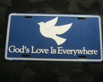 Sign of God's love everywhere + pigeon, white, blue ca. 1970 +/-, metal