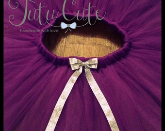 Purple Tutu Skirt with Silver Ribbon Bow. Perfect for birthdays and photo shoots.