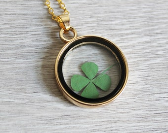 Round glass necklace with clover
