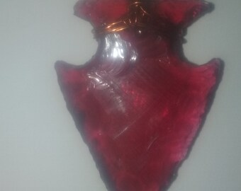 This is a Red Glass Arrow Head With A Deer Skin Strap so you can wear it .
