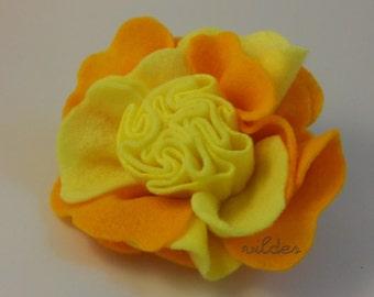 Brooch. Felt yellow rose.
